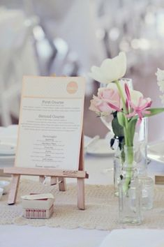 these tiny art easels are perfect for making your menu part of table's centerpiece (right). Photo by Poppy Lane via Style Me Pretty.