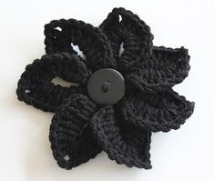 Here goes a free pattern for a Croco-Flower.  It's quite easy and gives you an interesting 3-D effect.  It can be worked in any yarn weight.  However, heavier weight yarns like worsted or bulky weights works best to give it a sturdier and nice texture.  Even the good ol' Red Heart Super Saver works fine for this flower.  Enjoy it!  Designed by Lianka Azulay