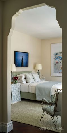 An Arched Doorway Frames The Serene Guest Bedroom.   Photo: Andy Frame /  Design