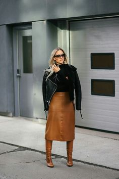 299c838e555 Keep warm nbsp this fall with an oversized cozy shearling coat. Style with  a tan leather skirt and riding boots