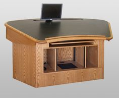 MCS-70 Command Center in Medium Oak Finish - Raised Position. Single or multiple monitors can be moved left or right on a sturdy track. This command center is on casters, has a pullout keyboard, front and rear rack, and a removable access panel. #Infocomm2012