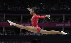 U.S. gymnast Gabrielle Douglas performs on the balance...