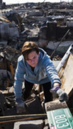 Meg McLoughlin helps sort through the remains of her father's house, which burned to the ground during Hurricane Sandy, in the Breezy Point neighborhood of Queens, New York November 11, 2012.  REUTERS/Andrew Burton (UNITED STATES - Tags: ENVIRONMENT DISASTER) via @AOL_Lifestyle Read more: http://www.aol.com/article/news/2016/10/27/27-photos-that-show-the-destruction-of-hurricane-sandy-4-years-a/21593225/?a_dgi=aolshare_pinterest#fullscreen