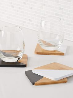 A Canadian design by Danica at Simons Maison We love this geo cutout: half natural bamboo and half painted for graphic contrast Set of 4 per package x White Coasters, Diy Coasters, Wooden Coasters, Table Coasters, Coaster Design, Coaster Set, Resin Crafts, Wood Crafts, Bamboo Care