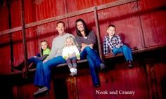 Cute family up in a barn