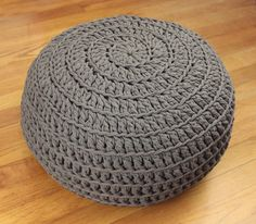 The homey comfort of T-shirt material teams up with crochet home decor to bring you the Comfy Crochet Pouf DIY. The thickness of the yarn makes this pattern look like woven twists, and it& the perfect size for an ottoman or a floor pillow. Crochet Home Decor, Crochet Crafts, Yarn Crafts, Crochet Projects, Diy Projects, Diy Tricot Crochet, Crochet Hooks, Crochet Cushions, Crochet Pillow