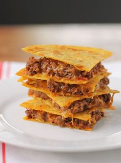 These Bacon BBQ Cheeseburger Quesadillas are a quick and easy weeknight meal or a perfect football party snack. Meaty, saucy and cheesy for under 300 calories or just 8 Weight Watchers SmartPoints! www.emilybites.com