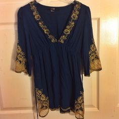 NEW Navy & gold lace top Brand new deep navy and gorgeous gold quarter sleeve top with amazing lace detail on sleeves and sides of top (2-3 picture) and string to tighten middle under breasts. This tip makes the girls look amazing  fp for exposure  Free People Tops Tunics
