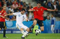 Spain 2 Greece 1 in 2008 in Salzburg. Giorgos Karagounis shoots for goal in Group D at Euro 2008.