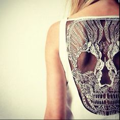 lace skull back dress. perfect for day to night wear. put a cardi or blazer over for work. reveal the cut out at night!