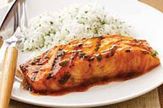 Easy BBQ Salmon  1/2 cup Barbecue Sauce  2 Tbsp.  brown sugar  1 green onion, sliced  4 salmon fillets or steaks (1 lb.)