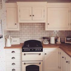 Cream kitchen with oak work surfaces.  www.instagram.com/hallwoodfurniture