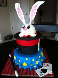 My friends' son was having a magic themed birthday party.  He wanted a rabbit coming out of a hat for his cake so this is what I made him.  Thanks for the inspiration @ CC!