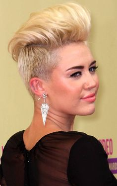 Miley Cyrus shows off her punk-inspired do. Bye bye Disney, London is definitely calling.