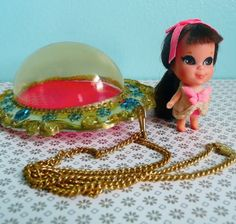 lucky lockets ! Little dolls that came in necklaces, ring, tiny pop bottles,   60's-70's. I loved these and they smelt nice too.  I still have some of the dolls minus the locket.