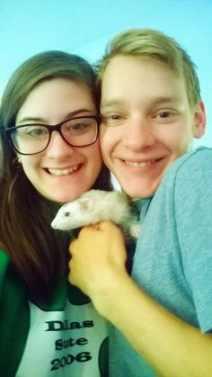 Kagura the ferret with her mommy and daddy.