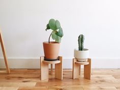 plant stands handmade in Los Angeles out of solid red oak. Rather than using hardware, they are assembled by using traditional joinery.