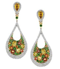 18k gold and palladium earrings with orange sapphires, yellow and white diamonds and tsavorites.