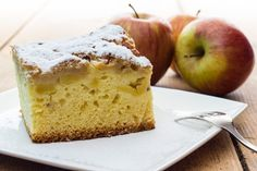 Method: Preheat oven to Lightly grease and base line a deep cake tin. Place the flour, baking powder, caster sugar, eggs, almond essence and melted butter into a mixing bowl and mix well together. Spread half the… German Apple Cake, Cake Calories, Apple Coffee Cakes, Sugar Eggs, Apple Cake Recipes, Baking Flour, Apple Slices, Cake Tins, Fall Desserts
