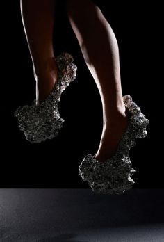 By using Aluminum foam, London-based Studio Swine designed this high heels that seem to come from space.