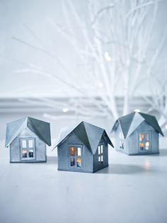 This set of Three Zinc House Tea Lights are so cute and would look great on a mantle or window ledge
