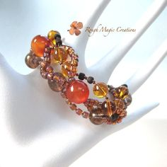 NEW! Big Chunky Bracelet Woven with Orange Carnelian Gemstones, Smoky / Amber Glass, Rustic Copper Heart. Handmade Jewelry by RoughMagicCreations http://www.etsy.com/listing/294961885