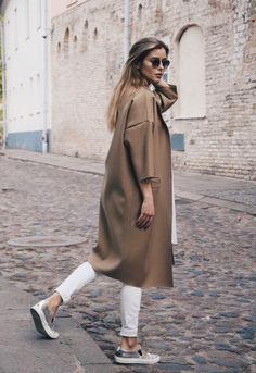 Camel duster coat, white Skinny pants & silver slip-ons