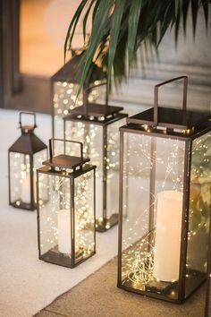 Magical, Festive Fairy Lights For Your Winter Wedding Decor ~ tall metallic lanterns filled with candles and fairy lights