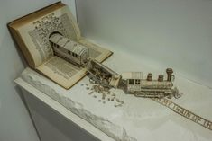 'Derailing my train of thought': book sculpture by Thomas Wightman... pic.twitter.com/KrzV2e8eXy