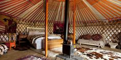 A view inside a traditional Mongolian yurt in the Highlands, complete with wood stove and Afghan rugs.