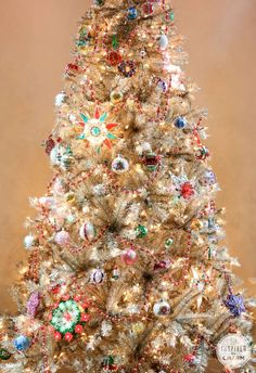 A gold tree dressed entirely in vintage ornaments! Check it out - Rockin' Around the Vintage Christmas Tree | Inspired by Charm