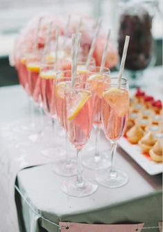 sparkling pink lemonade: recipe- 12oz can frozen pink lemonaide concentrate, 4 cups white cranberry juice cocktail, 1 qt club soda, garnish.