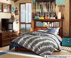 Surf sign, surf board decor, (awful bedding...) love everything else