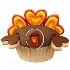 Tom Turkey Cupcakes - It's a novel idea to dress your turkey cupcakes this season…with cookies, of course! We've used heart Cut-Outs Fondant Cutters to cut feathers and wings and large open end of tip to cut the plump round face. Thanksgiving Cupcakes, Turkey Cupcakes, Holiday Cupcakes, Cute Cupcakes, Cupcake Party, Thanksgiving Decorations, Cupcake Cakes, Cupcake Ideas, Turkey Cake