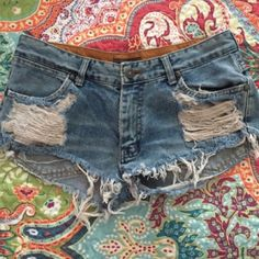 """Cute Jean shorts! Cute """"destroyed"""" Denim shorts. Great condition! Selling because they don't fit me right, they are a tad high waisted and I like low rise. Did not realize when buying but so cute on! Size is small/medium so not sure exactly but I wear 0 or 1 and fits good. Last seller said they wear 2 and they are a tad too small. Not sure of brand but really great quality Jean material. I was told brandy Melville! But fair warning, not sure on that!! Shorts Jean Shorts"""