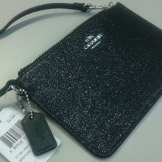 Coach Glitter Wristlet Glittery Coach Charcoal Grey Wristlet. Crafted in sparkling gunmetal silver glitter, this thoughtfully designed wristlet is large enough for a phone, cash, cards and other essentials. A dogleash clip on the strap and an embossed hangtag charm finish it with iconic signature style. Interior has slots for credit cards. Top zip with silver accents/hardware. Measures  Perfect for dinner or girls night out!!! Coach Bags Clutches & Wristlets
