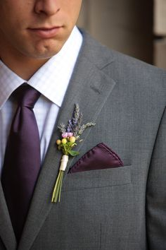 Cream hypericum berries, pink waxflower and lavender boutonnière... Love the long stems with small ribbon wrap.