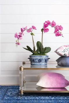 A beautifully convincing double orchid of the highest quality in traditional oval ceramic vessel. Artificial Fuchsia Orchids in Blue and White Chinese pottery.