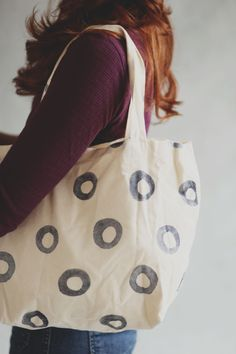 A beautiful hand painted circle design tote by Pine and Boon on www.mooreaseal.com