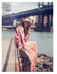 The model embraces pastels in Alpaca coat, knit cashmere sweater and silk skirt from Forte Forte