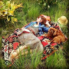 What's not to love about this colorful fall shot, complete with a vintage kilim blanket, a gorgeous gal, and her charming pooch?   Loving this #FeelingFall moment from @Ian Kennedy!