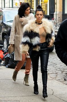Wrapped up: The TV star also rocked a furry fringe beige jacket, which boasted black and white stripes