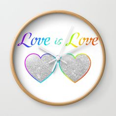 "#loveislove #rainbow #pride #mustahave #clock   Available in natural wood, black or white frames, our 10"" diameter unique Wall Clocks feature a high-impact plexiglass crystal face and a backside hook for easy hanging. Choose black or white hands to match your wall clock frame and art design choice. Clock sits 1.75"" deep and requires 1 AA battery (not included)."