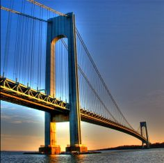 The Verrazano–Narrows Bridge, in the U.S. state of New York, is a double-decked suspension bridge that connects the boroughs of Staten Island and Brooklyn in New York City. It spans the Narrows, the reach connecting the relatively protected upper bay with the larger lower bay.  Its massive towers can be seen throughout a good part of the New York metropolitan area, including from spots in all five boroughs of New York City and in New Jersey.