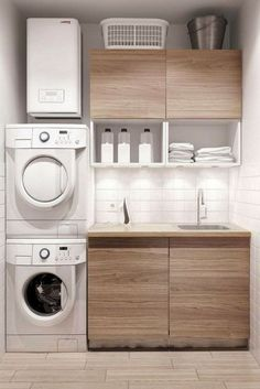 A small laundry room can be a challenge to keep laundry room cabinets functional, yet since this laundry room organization space is constantly in use, we have some inspiring design laundry room ideas. White Laundry Rooms, Modern Laundry Rooms, Laundry Room Layouts, Laundry Room Remodel, Laundry Room Cabinets, Laundry Room Organization, Laundry In Bathroom, Wood Cabinets, Basement Laundry