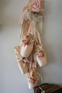 worn ballet point shoes wall hanging shabby cottage chic faded slippers embellished millinery rose feathers decor anita spero design Pink worn ballet point shoes wall hanging by AnitaSperoDesignPink worn ballet point shoes wall hanging by AnitaSperoDesign