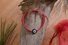Check out this item in my Etsy shop https://www.etsy.com/listing/526938273/evil-eye-adjustable-knit-waxed-cord