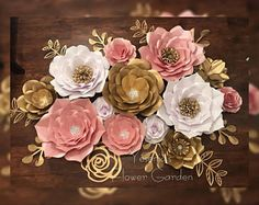 10 Large Paper flowers 8 Medium Paper Flowers 8 Small Paper Flowers 2 sets of decorative leafs and rose cut out- as per photo. Colors: Rose Gold, White and Gold (rose gold and gold paper flowers are sprayed) Order estimated time 4 weeks Large Paper Flowers, Paper Flower Wall, Crepe Paper Flowers, Paper Flower Backdrop, Giant Paper Flowers, Diy Flowers, Paper Decorations, Flower Decorations, Diy Adornos