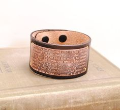 Not really a book but definitely something for book lovers: a cuff with the definitions of read and write.