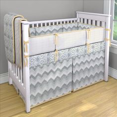 ikat/chevron neutral baby bedding. OBSESSED.